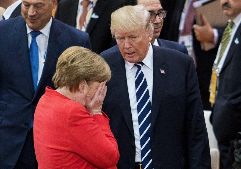 МЕРКЕЛ НА МАКА ЗА КОНСЕНЗУС НА Г-20 ПОРАДИ ТРАМП